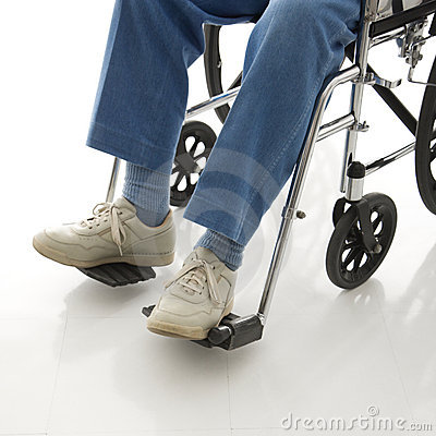 Legs in a wheelchair.