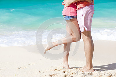 Legs of young couple on tropical turquoise boracay beach