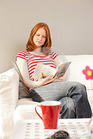 Leisure concept - woman reading a book