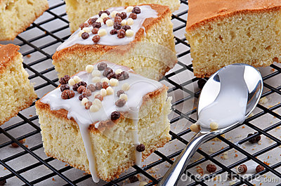 Lemon cake with icing sugar and chocolate balls