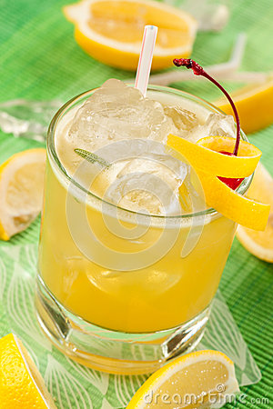 Lemon drink on a green background