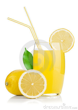 Lemon juice glass and fresh lemons