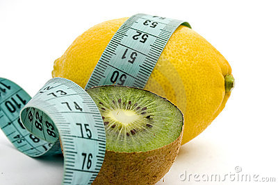 Lemon, kiwi and measuring tape