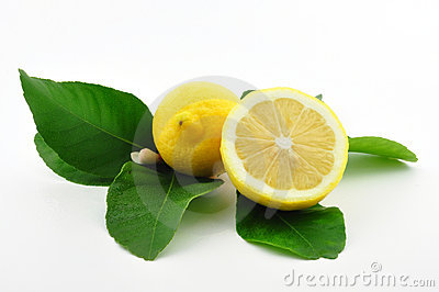 Lemon and lemon half with leaves