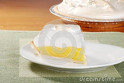 Lemon meringue pie on green placemat