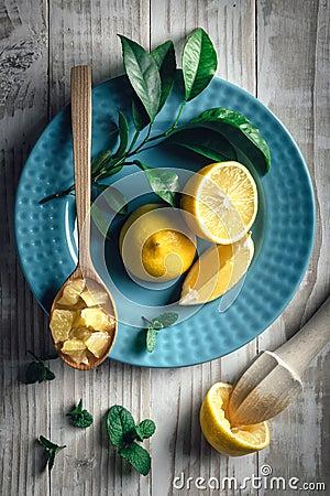 Free Lemon Pieces On Blue Plate Closeup Royalty Free Stock Photos - 114154098