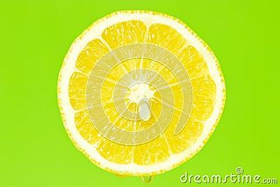 Lemon slice on green background