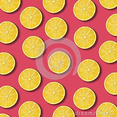 Free Lemon Slices Pattern On Vibrant Pomegranate Color Background Royalty Free Stock Photography - 110600757