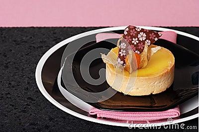 Lemon tart on pink and black