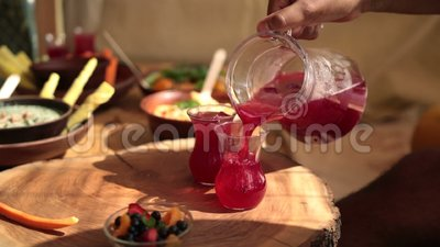 Lemonade pouring out into the glass from carafe stock footage