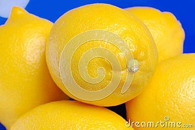 Lemons in a blue bowl.