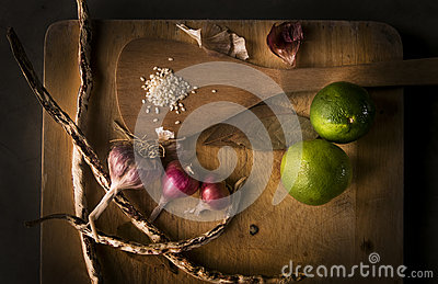 Lemons, garlics, sesame, beans on wood cropping block. Stock Photo