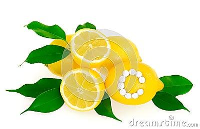 Lemons with vitamin c pills over white background