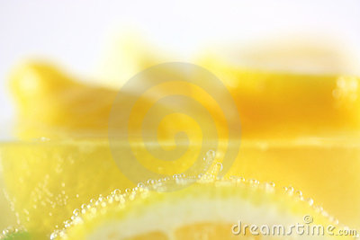 Lemons in water with bubbles