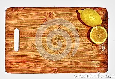 Lemons on wooden cutting board