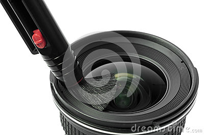 Lens and brush