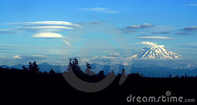 Lenticular cloud forming downwind of Mt. Rainier