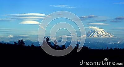 Lenticular cloud forming downwind of Mt. Rainier