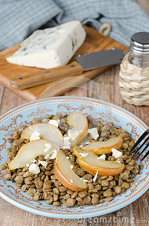 Lentil salad with caramelized pears closeup