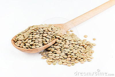 Lentils in a wooden spoon