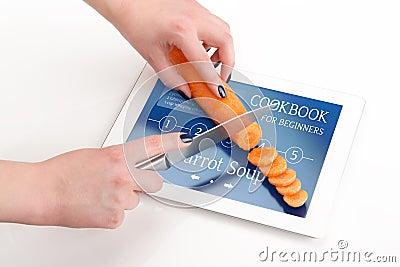 livre de cuisine pour des d butants avec une carotte image stock image 30219161. Black Bedroom Furniture Sets. Home Design Ideas