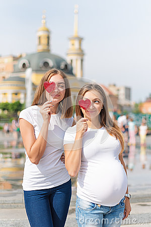 Free Lesbians Mothers, Pregnant Couple, Happy Samesex Family In The City Park At Summer. Women Holding Sweets, Heart Shaped Royalty Free Stock Photography - 96443357