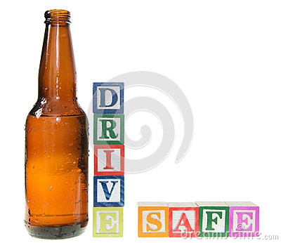 Letter blocks spelling drive safe with a beer bottle