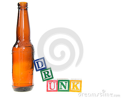 Letter blocks spelling drunk with a beer bottle