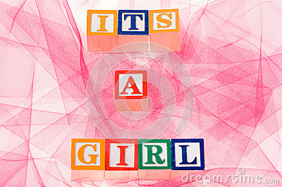 Letter blocks spelling  its a girl