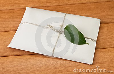 A letter with a green leaf