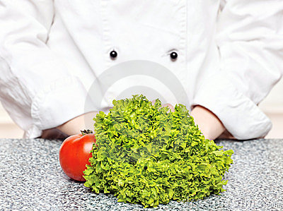 Lettuce and tomato in front of the chefs