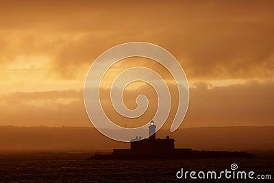 Leuchtturm am Sonnenaufgang