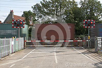 Level crossing lights and barrier with container train