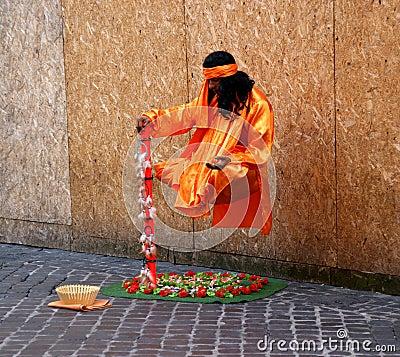 Levitating street performer Editorial Photo