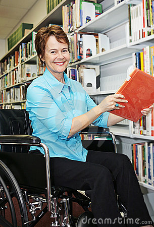 Free Librarian In Wheelchair Royalty Free Stock Photos - 2835918