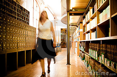 Librarian in a library aisle