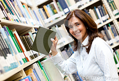 Librarian placing a book