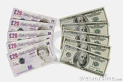 Libras británicas y dólares Imagen editorial