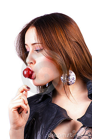 Licking lollipop woman on white