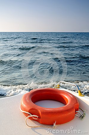Life buoy on the boat sailing in the sea