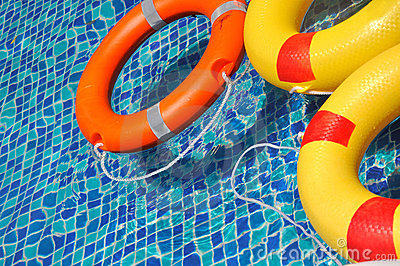 Life buoy floating in swimming pool