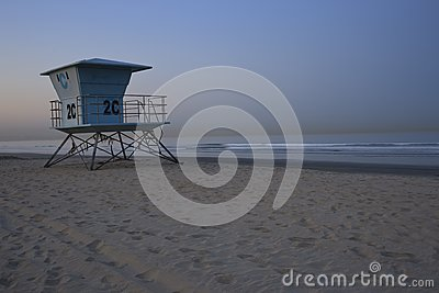 Life guard station on beach at sunrise