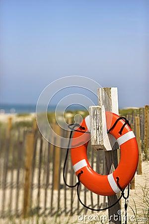 Life preserver on beach