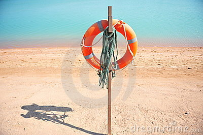 Lifebuoy on beach