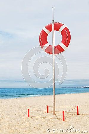 Lifebuoy on a beach in Portugal.