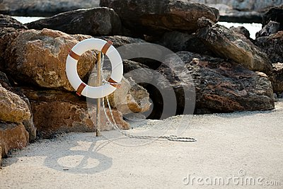 Lifebuoy hangs on a stick on the beach