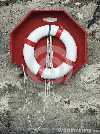Lifebuoy located on the old wall