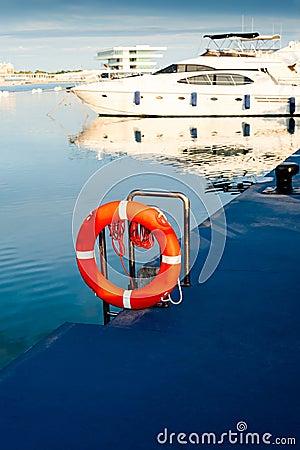 Lifebuoy with yacht