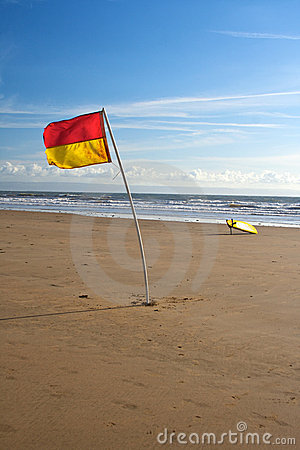 Lifeguard Flag and Surfboard