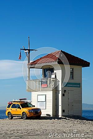 Lifeguard shack and yellow pick up truck